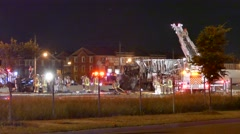Fireman climbing down ladder after fiery highway pileup Stock Footage