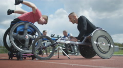 4K Young male wheelchair racer training with coach at racing track Stock Footage