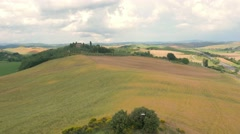 Aerial Drone shot of a green hill Stock Footage