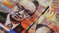 Rotating israeli money bills of 100 shekel - top view Stock Footage