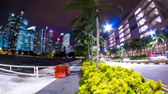 View of palm trees in the city at night Stock Footage
