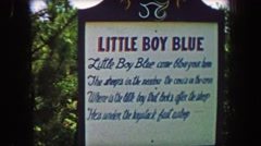 1955: Storyland theme park Little Boy Blue fairytale storybook exhibit. Stock Footage