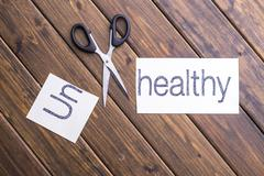 Cut paper with word unhealthy Stock Photos