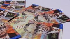 Rotating israeli money bills of 100 shekel Stock Footage