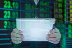Businessman and smart phone in hand with exchange rate blur background Stock Photos