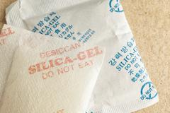 """Close up silica gel or desiccant, non-english text translate to """"Selica Gel D Stock Photos"""