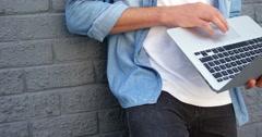 Fashionable man using laptop Stock Footage