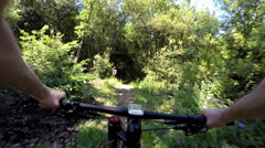 Extreme mountain biking in the forest. POV Original Point of View - stock footage