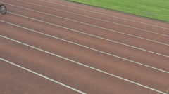4K Disabled wheelchair athletes competing in a race at race track Stock Footage