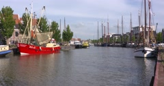 Traditional fishing boats and cutters moored in Harlingen Zuiderhaven Stock Footage