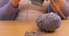 Senior woman knitting a wool Stock Footage