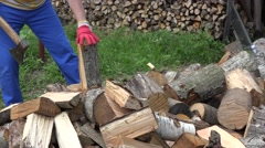 Close up of worker man chop wood with axe in country yard. 4K Stock Footage
