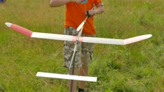 Boy is Launching Rubber Airplane Model Aircraft Model Sports Competition Stock Footage