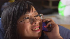 Portrait asian young woman talking on smartphone Stock Footage