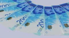 Rotating israeli money bills of 200 shekel - top view Stock Footage