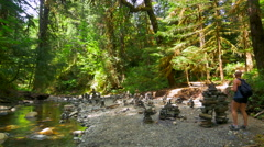 4K Forest Stream in Nature, Young Woman Explores Rock Sculpture Formations Stock Footage