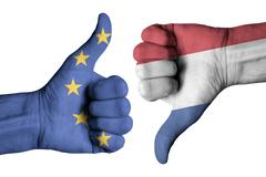 Netherlands and Europe flag on human male thumb up and down hands Stock Photos