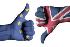 Union Jack flag and European flag on human hands Stock Photos