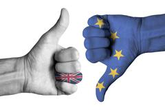 UK and Europe flags on human male thumb up and down hands - stock photo