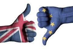 Union Jack flag and European flag on human hands - stock photo