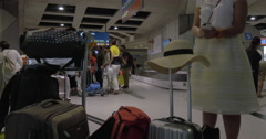 People at baggage claim area of the airport Stock Footage