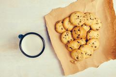 Homemade chocolate chip cookies and milk cup - stock photo