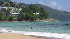 People swimming in the ocean. Beautiful island hotel. Surfers on the boards Stock Footage