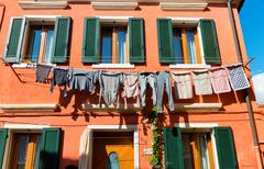 Washing drying on a line on a house in Burano - stock photo