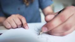Fashion designer sketching on white paper - stock footage
