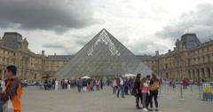 People at main entrance of the Louvre Stock Footage