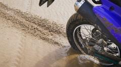 Motorcyclist scatters sand rear wheel - stock footage