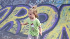 Little child girl have fun playing running over metal ramp for skaters Stock Footage