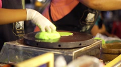 Asian night market. Chief cooking exotic sweets like candy and chewing gum. 4K - stock footage