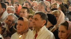 Congregation and the liturgy during Easter celebration in a Russian  Church Stock Footage