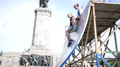 Ramp for skaters and rollerbladers teenager girl have fun slides down on butty Stock Footage