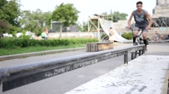 Riding a frystile tricks bike bicycle sliding over metal pipe in slow motion Stock Footage