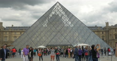 Crowd of tourists at the Louvre Pyramid Stock Footage