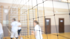 Playing volleyball in the gym. Grid closeup Stock Footage