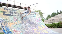 The ramp for skaters and rollerbladers - boy riding a skate active lifestyle Stock Footage