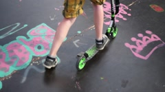 The ramp for skaters and rollerbladers - boy riding a scooter active lifestyle Stock Footage