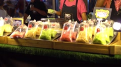 Asian night market. Chief cooking exotic sweets like candy and chewing gum. 4K Stock Footage
