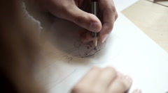 Cheerful fashion designer sketching in a studio Stock Footage