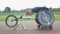 4K Professional disabled athlete training in racing chair on roller machine Stock Footage