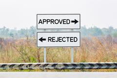 Road sign boards with approved and rejected text - stock photo