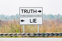 Road sign boards with truth and lie text Stock Photos