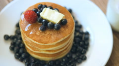 Pancake with honey, fresh blueberries and butter Stock Footage