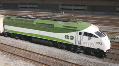 Green and white GO train pulls into Union station in Toronto, Canada. Stock Footage