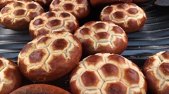 Football shaped bread rolls Stock Footage