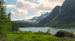 Mountain landscape with clouds and lake at Alpe Devero Stock Footage