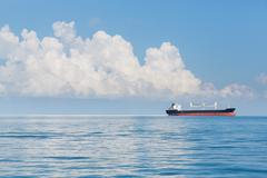 Cargo ship sailing in ocean Kuvituskuvat
